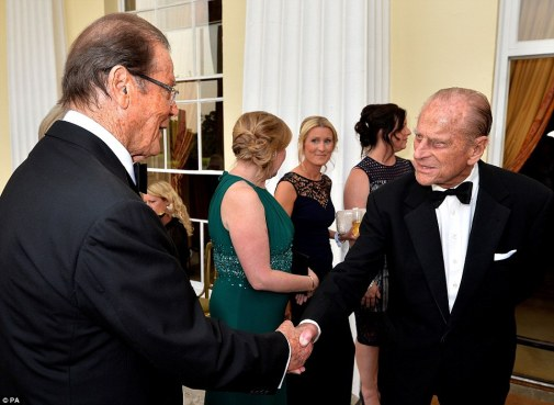 On her majesty's secret service: Former Bond Sir Roger Moore greets Prince Philip