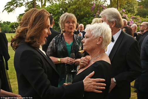 Catching up: Dame Judi was seen deep in conversation with Bond producer Barbara Broccoli