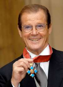 Sir Roger Moore with the CBE
